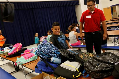 Video+Story: Community Rallies to Donate Backpacks and School Supplies