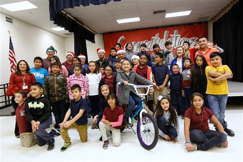 Masons Deliver New Bikes to Moye Elementary Students