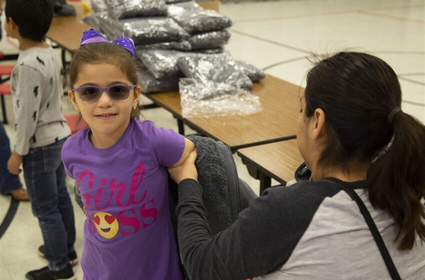 Lumbre Motorcycle Club Donates Winter Coats to Campestre Elementary Students