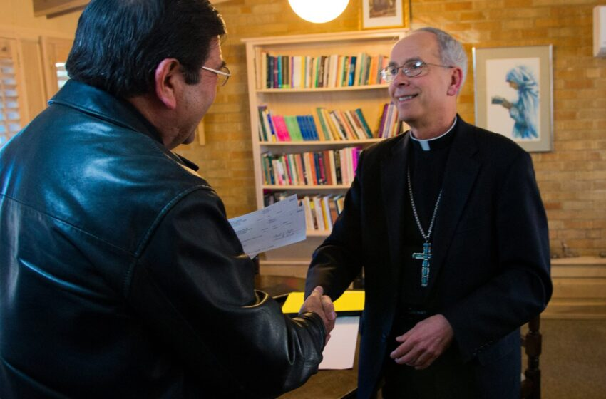 El Paso Diocese presents check for $73,000 to Juarez for Papal assistance