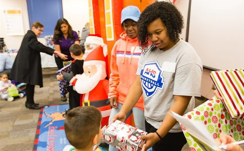 Khalid's Mom, Sister Surprise Serna Students with Christmas Gifts