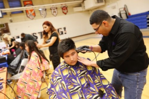 Henderson students get a special holiday treat: free haircuts