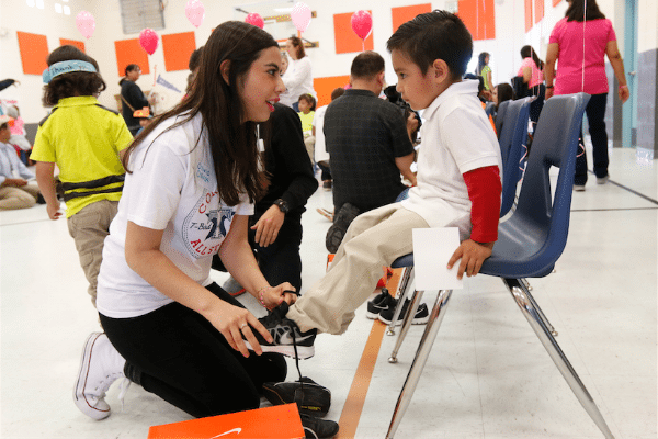 Braden Aboud Foundation gives Johnson Elementary Students New Shoes