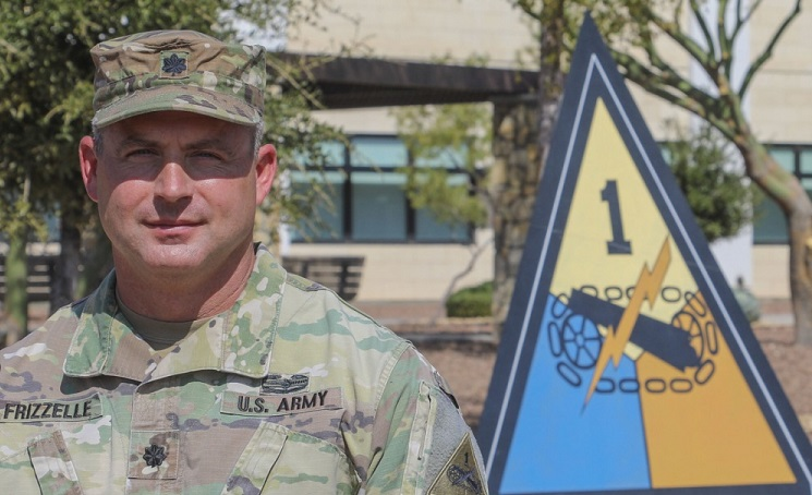 Lt. Col. Bryan W. Frizzelle poses outside 1st Armored Division Headquarters prior to his promotion ceremony Oct. 16. Frizzelle is one of 14 Lieutenant Colonels from across the U.S. Army selected to serve in a higher grade in a new Army Talent Management program being implemented globally under the brevet program. Frizzelle currently serves as the 1AD G3 Operations Chief. Maj. Gen. John B. Richardson IV, III Corps and Fort Hood Deputy Commanding General, promoted Frizzelle to the rank of Colonel in a special ceremony at 1AD Headquarters Oct. 16. Richardson served as a Cadre member at the U.S. Military Academy at West Point when Frizzelle was a Cadet over 20 years ago. | Photo By Maj. Allie Payne / Staff Sgt. Nicholas Brown-Bell