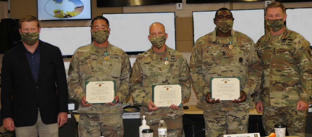 Secretary of the Army Ryan McCarthy (far left) and Army Chief of Staff Gen. James McConville (far right) awarded Maj. Bryce Asagi, Chief Warrant Officer Four Jeremy Sager and Sgt. 1st Class Jarvis Smith with Army Commendation Medals on Sept. 23 at Yuma Proving Ground, Ariz. The three were honored for their actions after a vehicle collision near Yuma on Sept. 19. | Photo by Ana Henderson, Yuma Proving Ground Public Affairs