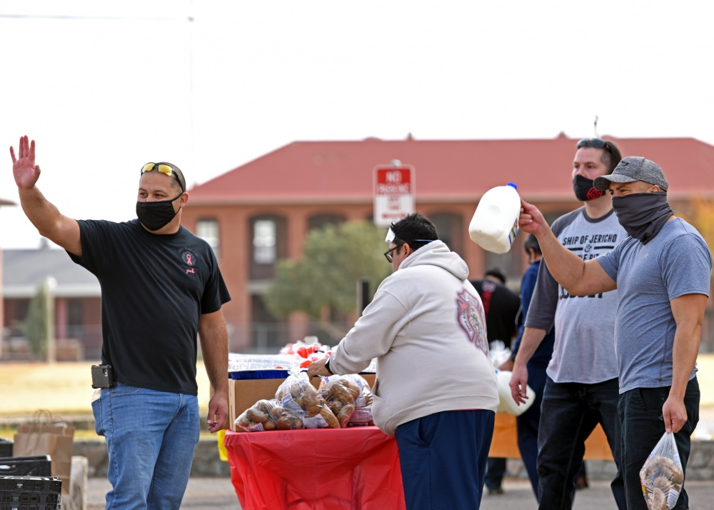Firefighters from the Fort Bliss Fire Department waved goodbye to Gold Star Families, Nov. 23, 2020, at the annual FBFD turkey drive. The FBFD donated full Thanksgiving meals to 25 families identified by Fort Bliss Survivor Outreach Services. The drive is traditionally held in the El Paso, Texas, community, but this year FBFD partnered with Fort Bliss SOS to help Fort Bliss Gold Star Families. | Photo by Michelle Gordon Fort Bliss Public Affairs Office