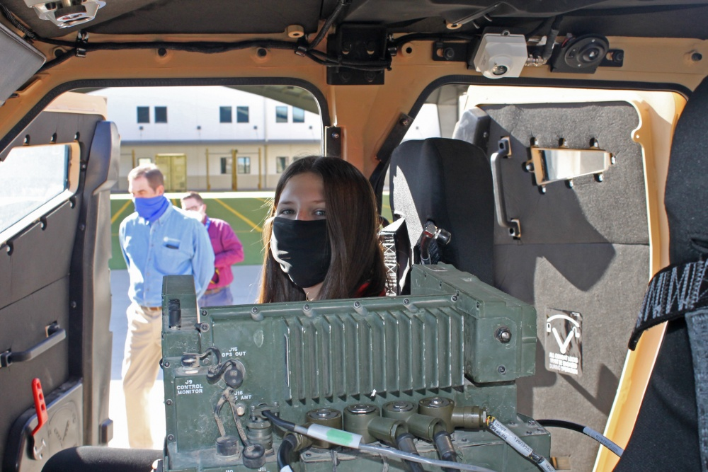 Payton Mitchell, 12, looks out from a Joint Light Tactical Vehicle (JLTV) during her visit to the Joint Modernization Command at Fort Bliss, Texas, on Nov. 17, 2020. Payton was invited to tour JMC after she wrote 500 letters to Soldiers thanking them for their service. (Photo by Maj. Michael J. Van Kleeck / U.S. Army Joint Modernization Command