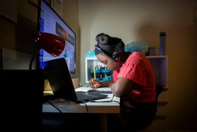 Hezekiah Hunter has been learning from home due to the pandemic and has struggled to manage the onslaught of assignments that come with remote learning. Credit: Amna Ijaz/The Texas Tribune