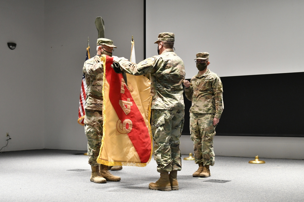 Col. Duane Burk, 647th Regional Support Group commander, and Command Sgt. Thomas Brehmer, 647th Regional Support Group command sergeant major, uncase the brigade colors during a socially distanced transfer of authority ceremony at Sage Hall, Fort Bliss, Texas, Jan. 25, 2021. The 647th Regional Support Group assumed the Fort Bliss Mobilization Brigade mission from the 648th Regional Support Group. |  U.S. Army photo by Capt. Brandon D. Fambro