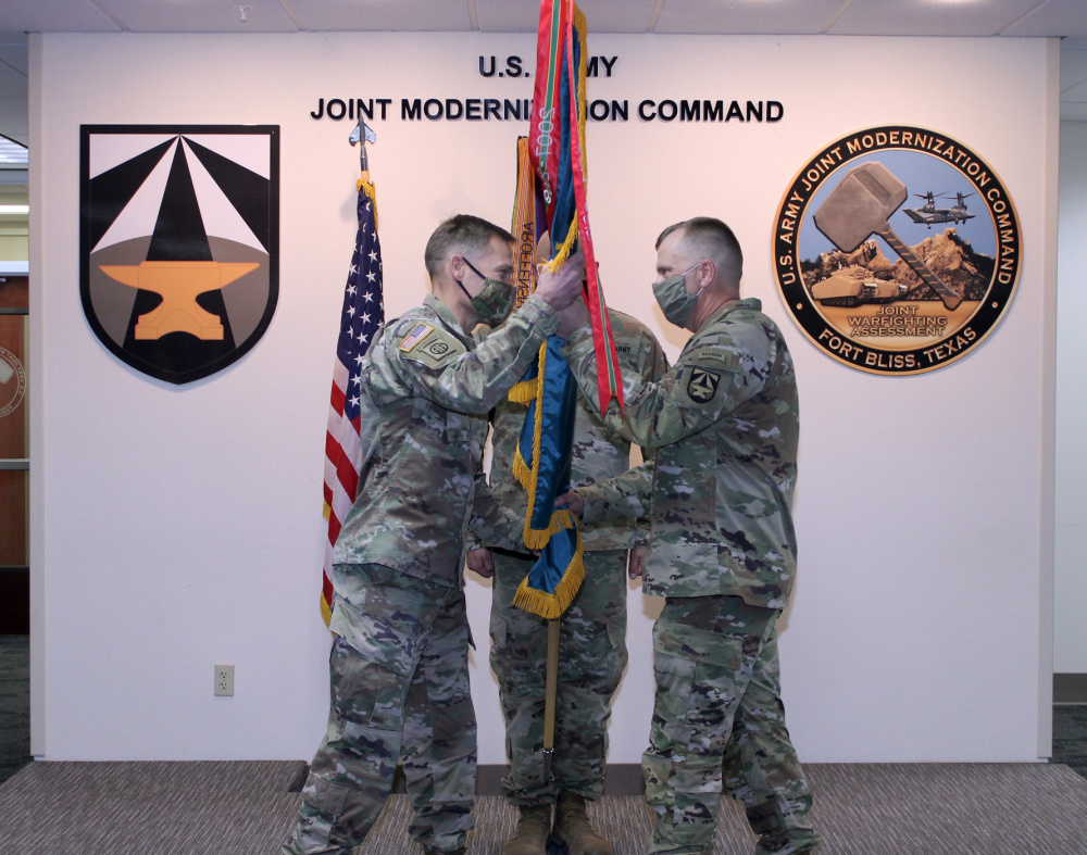Command Sgt. Maj. Christopher Gunn (right) passes the JMC colors to Col. Tobin Magsig during Gunn's Relinquishment of Responsibility Ceremony on Jan. 19 at Fort Bliss | Photo by Maj. Mike Van Kleeck / U.S. Army Joint Modernization Command