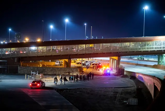 U.S. Customs and Border Protection agents escorted a group of migrants near the Paso del Norte International Bridge in El Paso in 2019. Credit: Ivan Pierre Aguirre for The Texas Tribune