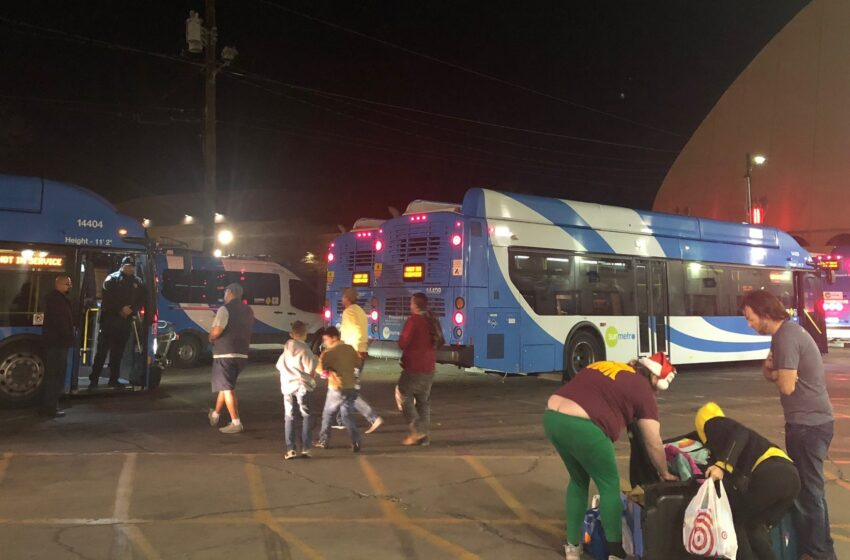 FILE PHOTO: Migrants head to Sun Metro Buses shortly before Christmas 2018 after being released in El Paso  |   Photo by Andra Litton
