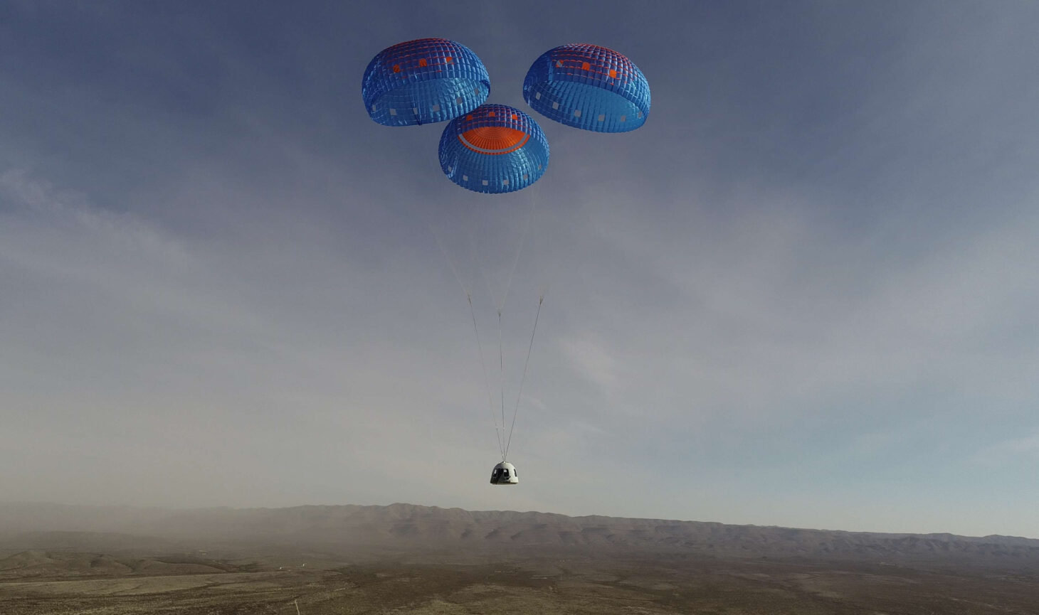 The New Shepard crew capsule outfitted with astronaut experience upgrades landing at Launch Site One.  |  Photo courtesy Blue Origin