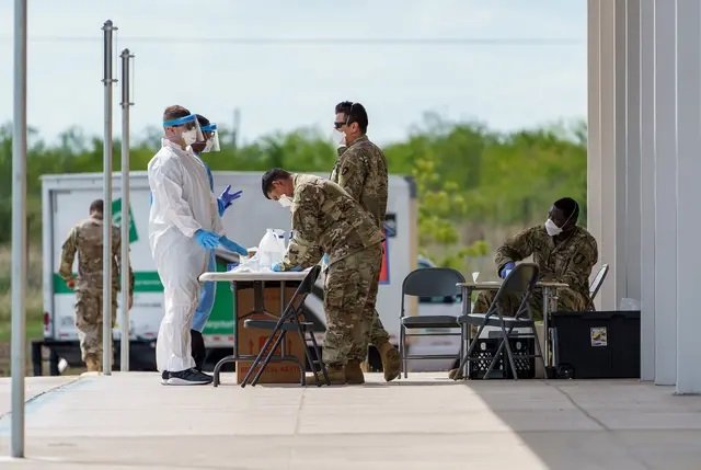 Soldiers with the Texas National Guard worked at a mobile COVID-19 testing site last summer at Uhland Elementary School. Credit: Jordan Vonderhaar for The Texas Tribune