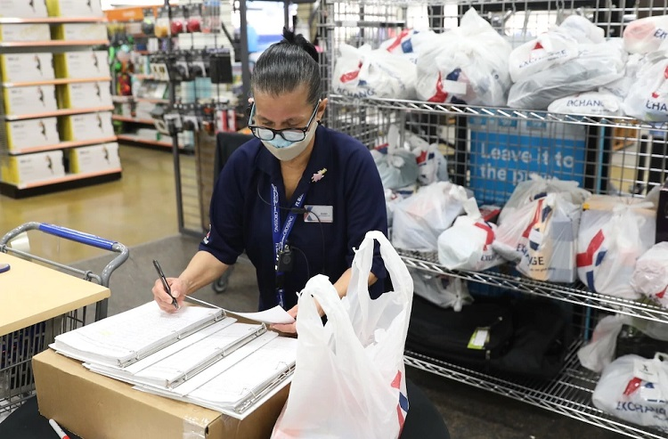 AAFES Main Exchange associate Susan Morales logs items before they are loaded and delivered to quarantined military personnel at Fort Bliss  | Photo by  Stephanie Santos