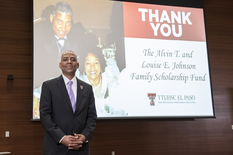 Renard U. Johnson, owner of Management and Engineering Technologies International Inc. (METI), wrote a check for the Hunt School of Dental Medicine to create the Alvin T. and Louise E. Johnson Family Scholarship.  | Photo courtesy TTUHSC