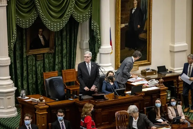 Lt. Gov. Dan Patrick presides over the Senate session on March 20. On Tuesday, the upper chamber passed a two-year state budget, but several questions remain about expected federal aid. Credit: Jordan Vonderhaar for The Texas Tribune