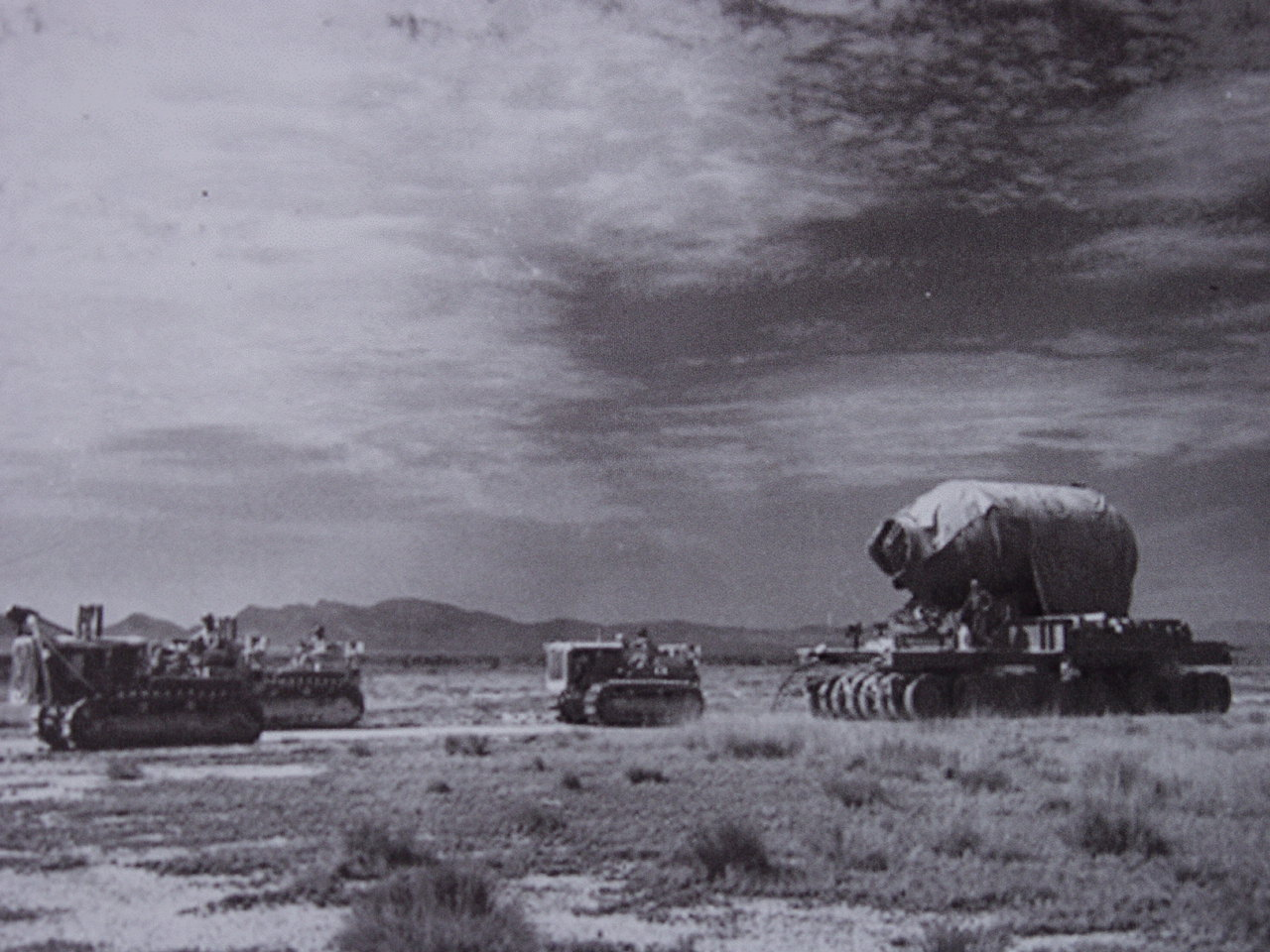 "Military personnel are seen moving ""Jumbo"" to Trinity Site.  ""Jumbo"" was built with the intention of imploding the device inside. The $12 million dollar vessel was never used for that purpose because by the time the test was nearly ready, scientists were confident that it would work. What remains can still be seen at Trinity Site today. 