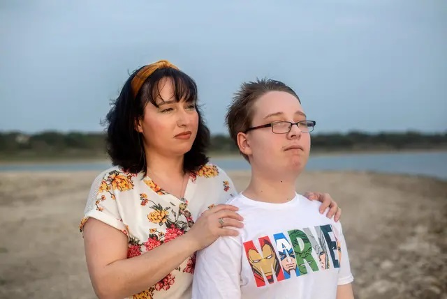 Trish and her 12-year-old son look out into the sunset at Canyon Lake on April 13, 2021. Trish earns too much to qualify for Medicaid in Texas but too little to afford her own health insurance. Her son does qualify for Medicaid. Credit: Montinique Monroe for The Texas Tribune