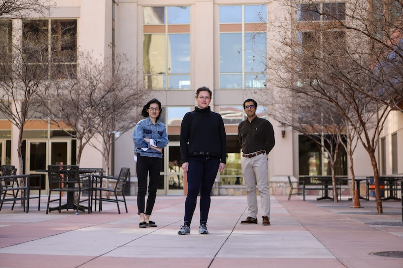 Lela Vukovic, Ph.D., center, assistant professor of chemistry and biochemistry at The University of Texas at El Paso, combines chemistry and artificial intelligence to develop new computational tools to design sensors that detect the presence of brain-relevant molecules, and thus gain a better understanding of human behavior. With Vukovic are, from right, Payam Kelich, doctoral student, and Huanhuan Zhao, master's student researcher. Photo: J.R. Hernandez / UTEP Communications