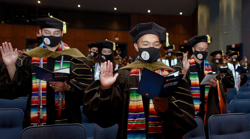 Students in The University of Texas at El Paso's first graduating class from the School of Pharmacy take the oath of a pharmacist during the Pharmacy hooding ceremony May 13, 2021. UTEP will award its first Doctor of Pharmacy (Pharm.D.) degrees to 40 graduates at the University's Spring 2021 Commencement ceremony May 15, 2021, at Sun Bowl Stadium. Photo: Laura Trejo / UTEP Communications