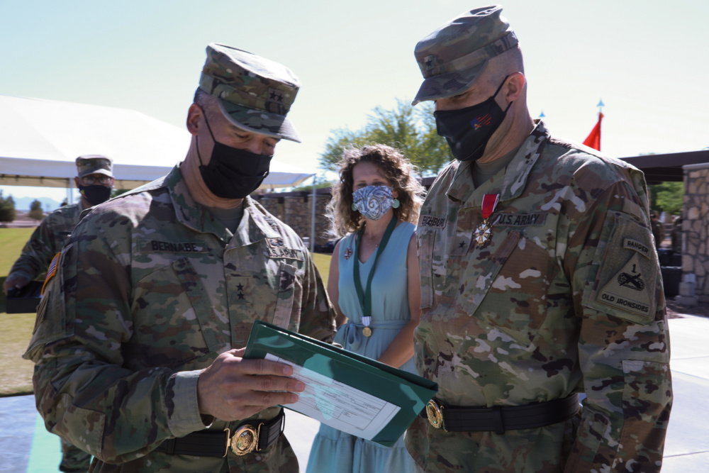 Maj. Gen. Sean Bernabe, senior commander, 1st Armored Division and Fort Bliss, presents the Legion of Merit to Brig. Gen. Matthew Eichburg, deputy commanding general-operations, during a retreat ceremony in Eichburg's honor at Fort Bliss May 12. After more than two years of service to Fort Bliss, including two separate assumptions of command of the 1st Armored Division, Eichburg departs to become the Chief of Staff, U.S. Army Central Command, Shaw Air Force Base, S.C.   |  U.S. Army photo by Staff Sgt. Nicholas Brown-Bell