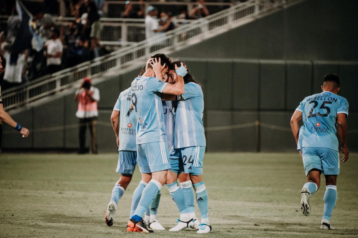 Forward Leandro Carrijo (lf) celebrates his last second, game-tying goal with teammate Yuma (rt)  | Photo courtesy El Paso  Locomotive FC
