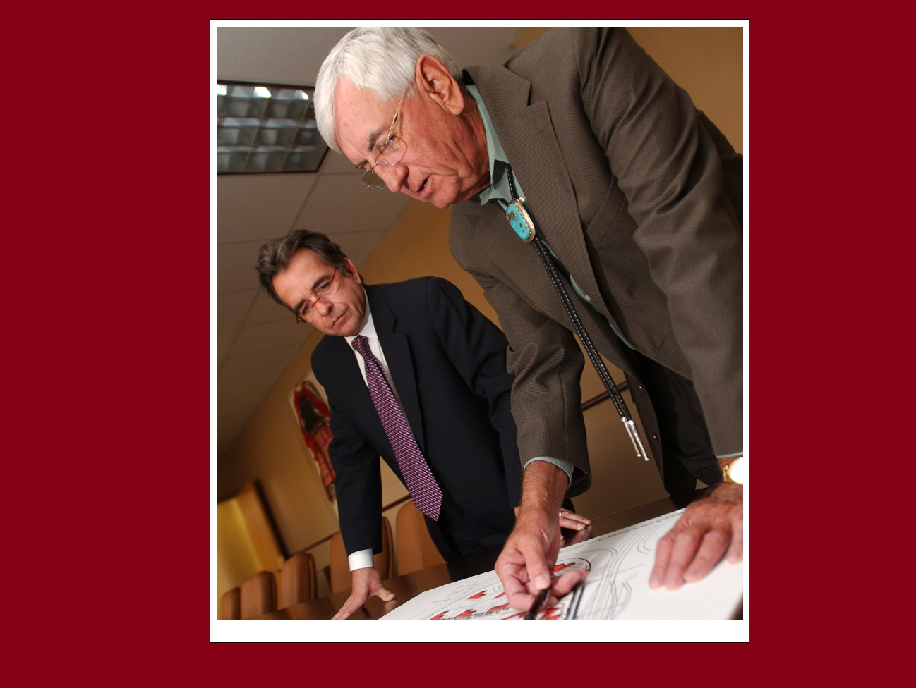 Kevin Boberg, left, and Garrey Carruthers look over an architectural rendering of the new Arrowhead Research Park in 2007, when Carruthers was dean of NMSU's College of Business and Boberg was the college's Carruthers Chair in Economic Development. |   NMSU photo by Darren Phillips