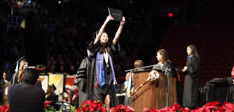 A UTEP student celebrated at the 2018 winter commencement ceremony. (Photo courtesy of the University of Texas at El Paso