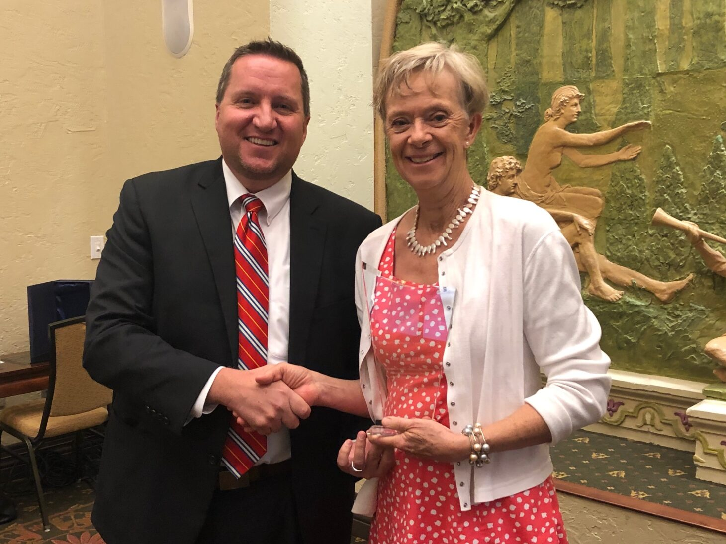 Jeffrey Coburn, special agent in charge of the FBI's El Paso division, congratulating Stephanie Karr, One Fund El Paso director, holding the FBI's 2020 Director's Community Leadership Award.  |  Photo courtesy EPCF