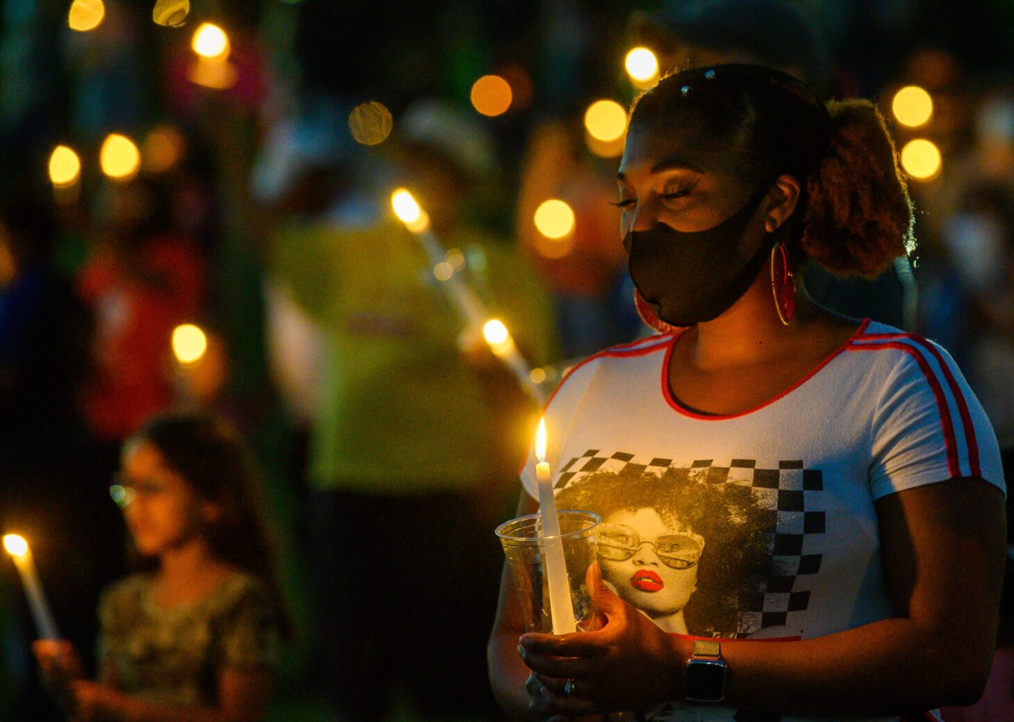 People hold candles during New Mexico State University's Juneteenth celebration last year. This year's event will take place at 6 p.m. Saturday, June 19, at Presley Askew Baseball Field. | NMSU photo by Josh Bachman