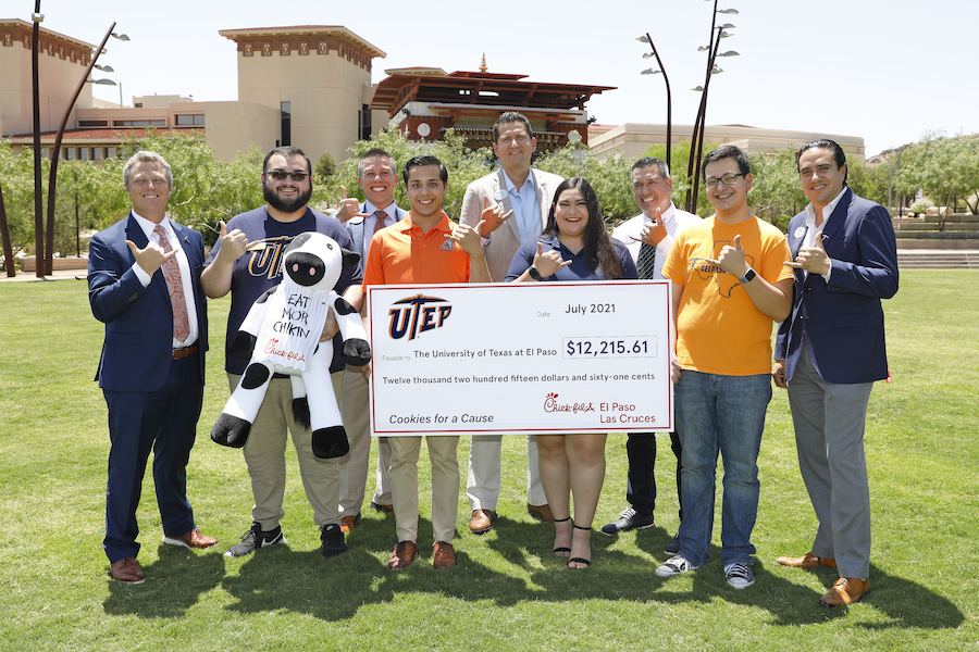 The University of Texas at El Paso's Student Emergency Fund was bolstered by a $12,215 gift from Chick-fil-A presented Friday, July 16, 2021, during a ceremony at Centennial Plaza. The money was collected during the restaurant's Cookies for a Cause campaign in April 2021. Taking part in the ceremony were, from left, Jake Logan, vice president for institutional advancement at UTEP; Carlos Chavez, UTEP Student Government Association (SGA) senate majority leader/senator-at-large; Anthony Martinez, Chick-fil-A operator; Carlos Mora, SGA senator-at-large; Sergio Denver Chavez, Chick-fil-A operator; Kimberly Sanchez, SGA senator-at-large; Marc Zayas, Chick-fil-A operator; Armand Avila, SGA vice president for external affairs; and Edgar Ortega, Chick-fil-A operator. Photo: Laura Trejo / UTEP Communications