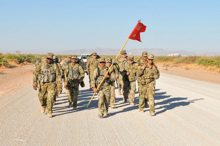 Soldiers assigned to the 319th Engineer Support Company and Lt. Col. Lisa Jaster, commander, 980th Engineer Battalion, conduct a 10-kilometer ruck march at Fort Bliss, Texas, June 16, 2021. The ruck march was the culminating event for the Extended Combat Training and provided service members an opportunity to exhibit pride and esprit de corps. |  U.S. Army photo by Capt. Brandon Fambro