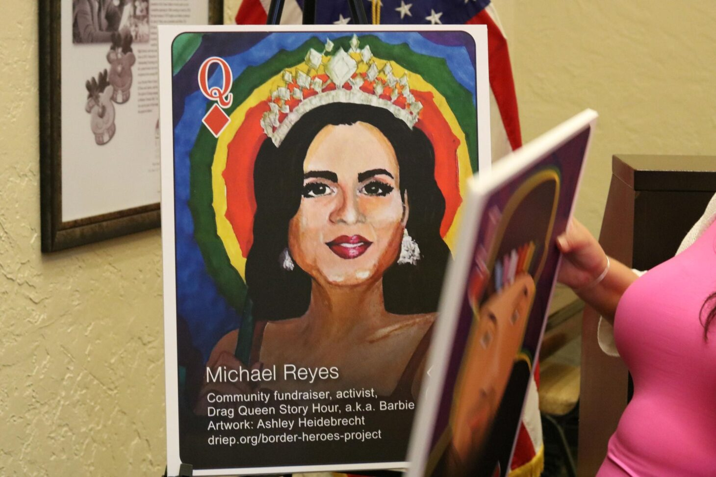 A display of one of the cards included in the LGBTQ+ Border Heroes deck featuring community organizer Michael Reyes, also known as Barbie.