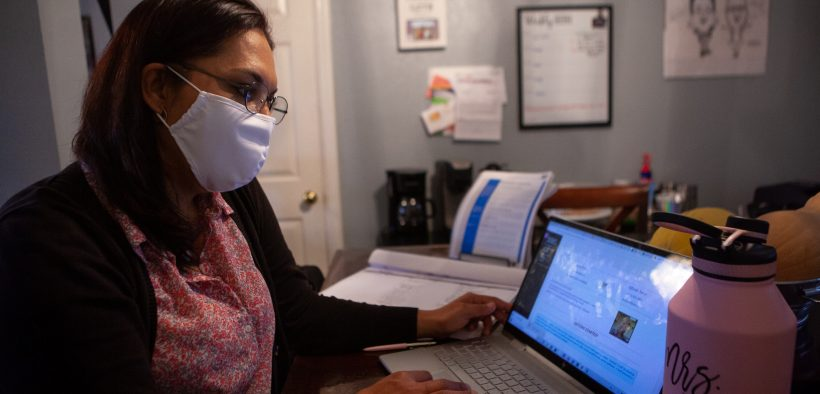 Giselle Paredes sits at her dining room table to work on her online classes in accounting from El Paso Community College.  |  Corrie Boudreaux/El Paso Matters