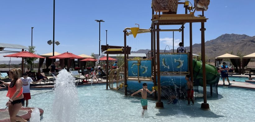 Families cool down at Camp Cohen in Northeast El Paso on June 1. It's one of three city-funded water parks that opened in June.  |   Photo by Andrea Valdez-Rivas/KTEP