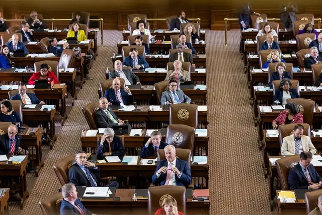Lawmakers at their desks on the House floor on May 30, 2021. Credit: Jordan Vonderhaar for The Texas Tribune