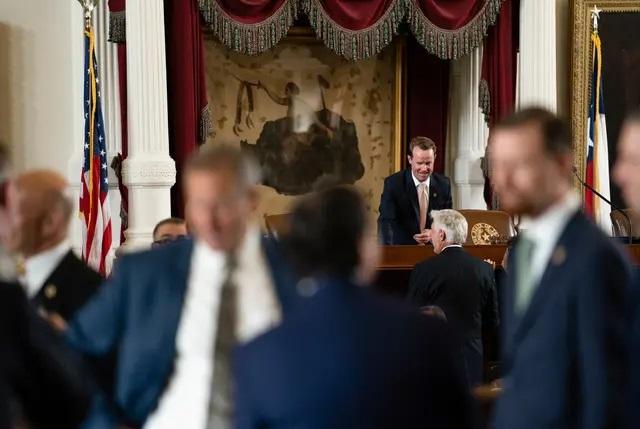 Texas House Speaker Dade Phelan speaks with legislators on the opening day of the special legislative session on Thursday. Credit: Sophie Park/The Texas Tribune