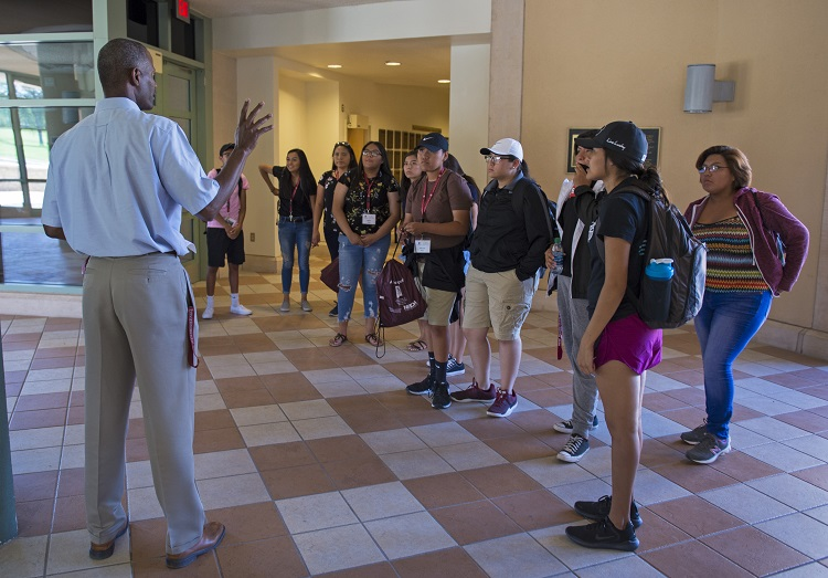 Rolston St. Hilaire (left), New Mexico State University Plant and Environmental Sciences department head, gives a presentation to a group of Native American high school students. NMSU's Indian Resources Development and Navajo Technical University have received a four-year, $250,000 grant to develop experiential learning opportunities for Native American students at New Mexico land-grant institutions.  | Photo courtesy NMSU
