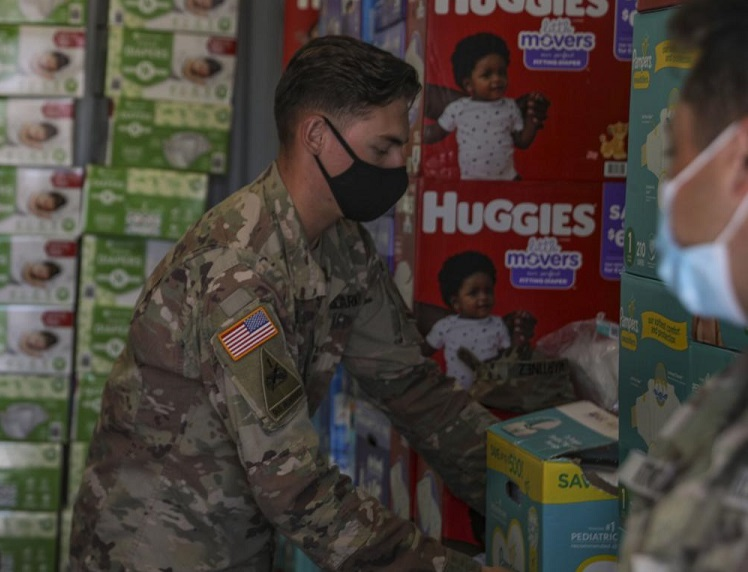 Soldiers with 1st Battalion, 6th Infantry Regiment, 2nd Armored Brigade Combat Team, 1st Armored Division stack and inventory supplies at Doña Ana Village near Fort Bliss, New Mexico, Aug. 25, 2021 |   U.S. Army photo by: Staff Sgt. Michael West/2ABCT