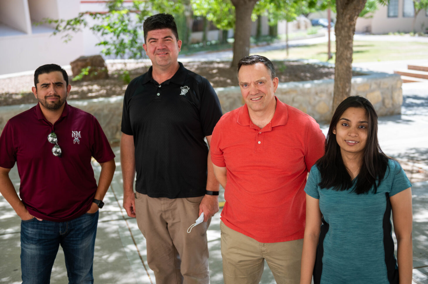 From left, New Mexico State University College of Business faculty members Victor Pimentel, Barry Brewer and Donovan Fuqua stand with Ph.D. student Shravya Dharba, all of whom collaborated on a data analysis project to determine how the COVID-19 pandemic drove food supply chain instability. | NMSU photo by Josh Bachman