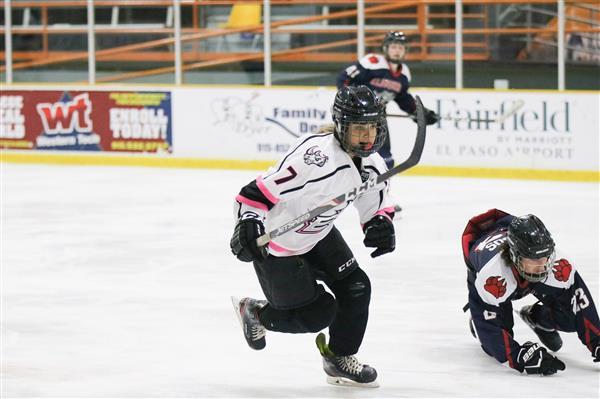 Camryn Heon skating in an EP Rhinos uniform