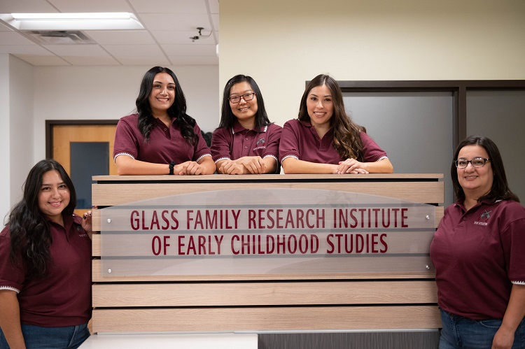 From left, Christina Morales, Emmarie Heredia, Wenjie Wang, Luzia Manuel and Lizette Monge make up the Family and Friends project team at New Mexico State University's Glass Family Research Institute for Early Childhood Studies. The project is funded by the Brindle Foundation.  |  NMSU photo by Josh Bachman