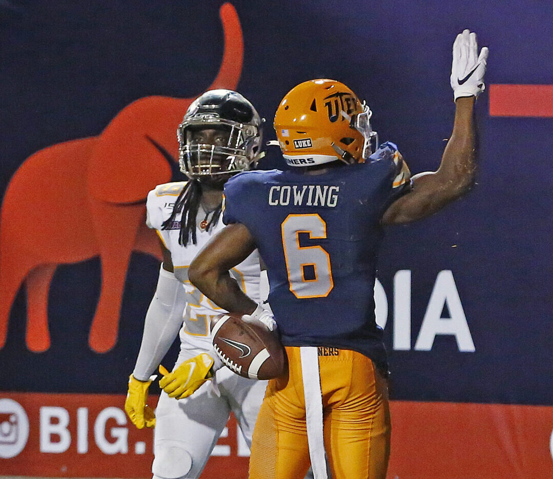UTEP's Jacob Cowing celebrates after scoring a touchdown, pointing at the fans in the Sun Bowl