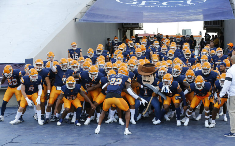 UTEP Miners exit their dressing room, led by Paydirt Pete, at the Sun Bowl