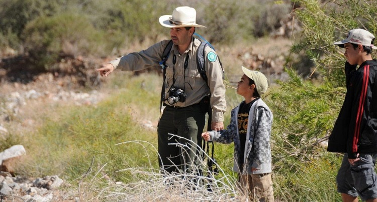 Franklin Mountains State Park Superintendent, Dr. Cesar Mendez, leading a nature hike.