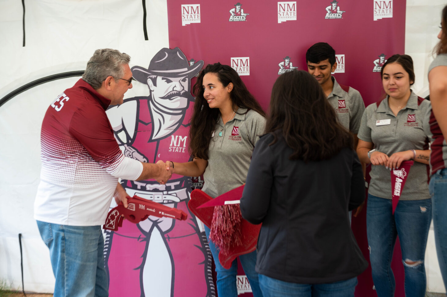 NMSU President John Floros, talks with NMSU students work as part of the Aggie Welcome and orientation staff Saturday August 14, 2021 during during the second day that campus dorms were open for students to move into. August 14, 2021. (NMSU photo by Josh Bachman)